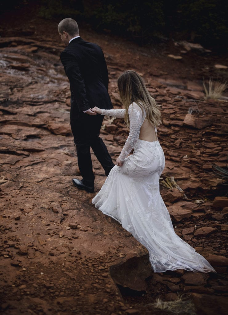 a Bride and groom at their elopement that flew with their wedding dress