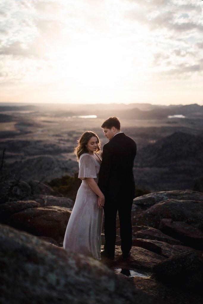 couple at their elopement at Mount Scott in Wichita Mountain Wildlife Refuge.