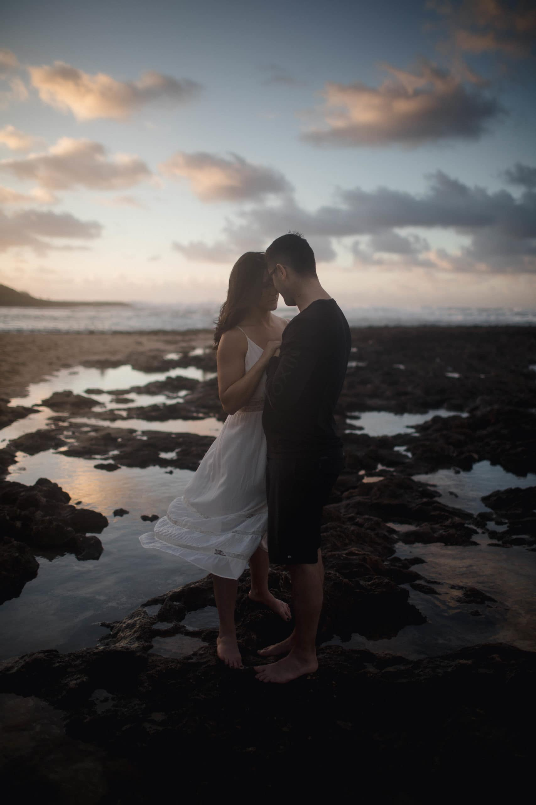 Couple on the beach in Hawaii posing for their elopement photographer.