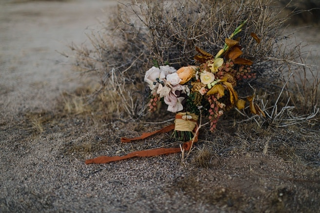 Desert Wedding Bouquet with silk ribbon and orange and yellow flowers at a self solemnization ceremony.