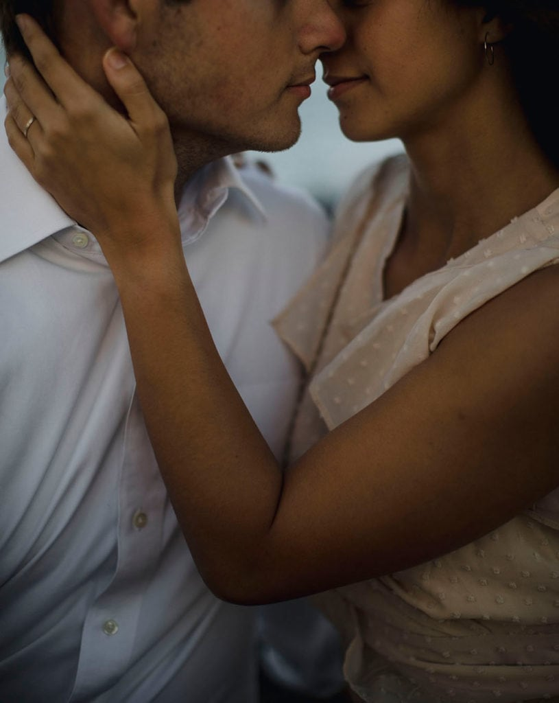 Couple embracing at their elopement in Oahu at turtle Bay resort