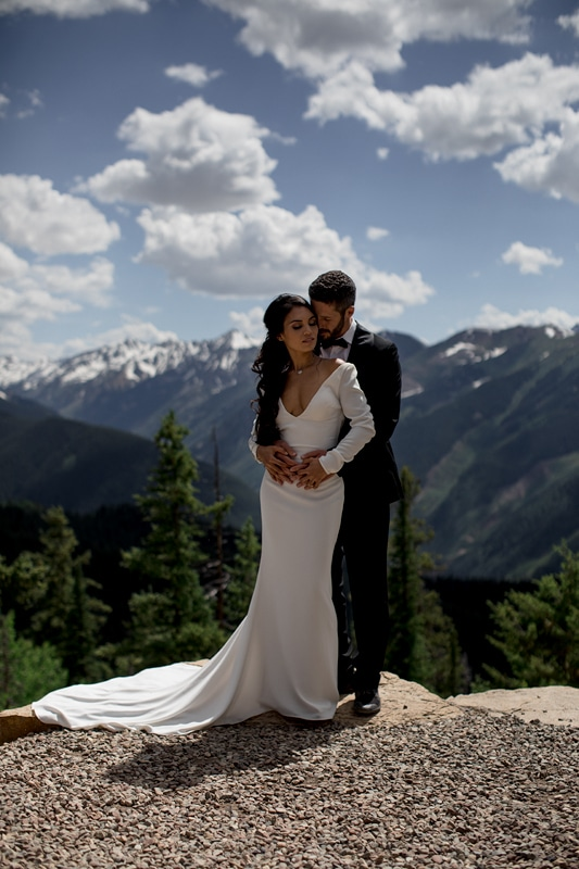 Couple on their wedding day in Colorado posing for their elopement photographer
