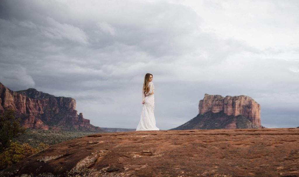A bride in sedona in a portrait session with her elopement photographer.