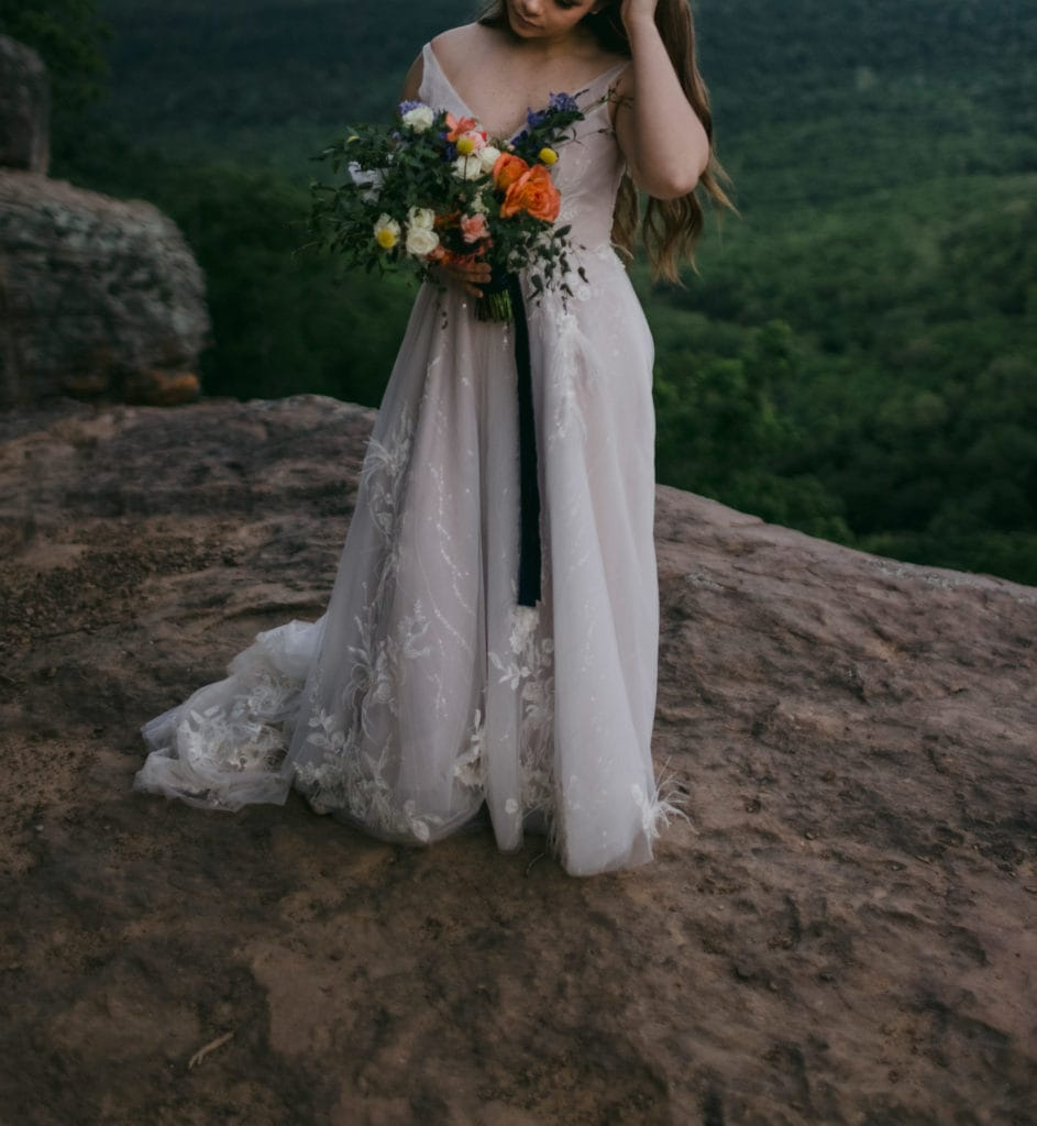 Bride holding her wedding bouquet in Yosemite National Park after her elopement.
