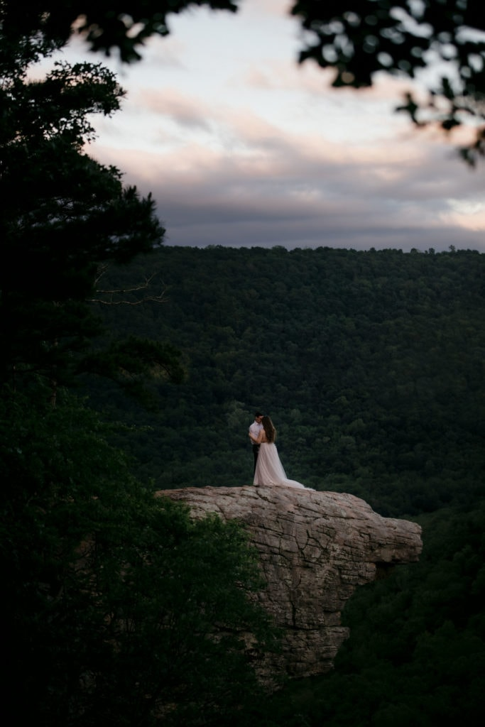 A just  married couple that renewed their wedding vows on the side of a  cliff at Whitaker's Point in Arkansas